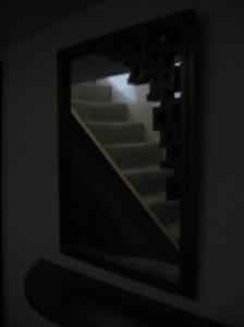 escalón de espejos los espacios